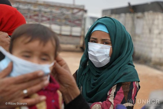 Syria. A Syrian youth wears a face mask during an awareness workshop on Coronavirus